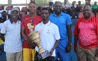 Benjamin Fumi holds the trophy with pride