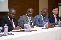 CEO of the Universal Merchant Bank, John Awuah and some government representatives during the signin