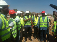 Isaac Asiamah interacts with the contractors on one of his inspections