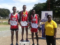 The medal winners with their certificates, looking on is a member of Sports Directorate