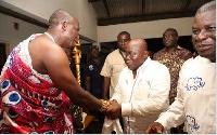 Nana Akufo-Addo interacting with one of the Nkwanta chiefs