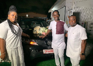 Yaw Sarpong poses with his new car