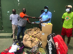 A member from Project Soliver  making the donation