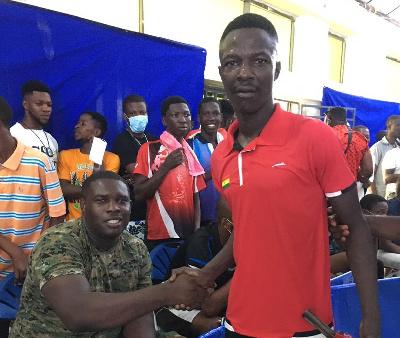 S/Sgt. Moses Tagoe with Emmanuel Ofori