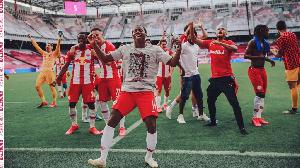 Majeed Ashimeru celebrating with his teammates