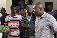 Three of the Kwabenya suspects in cuffs at the Police Station