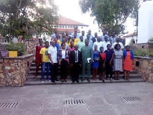 Professor Oduro Owusu in a group photo with some members of the Sports Directorate and students