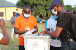 File photo of an official sealing the ballot box