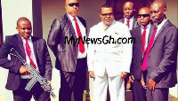 File photo: A pastor flanked by his bodyguards