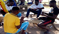 Some of the students playing cards