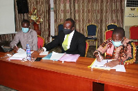 Mr Emmanuel T. Jumpah (extreme right in African print) and some participants at the workshop
