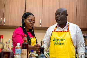 GIHOC Distilleries CEO, Maxwell Kofi Jumah with the host in the kitchen