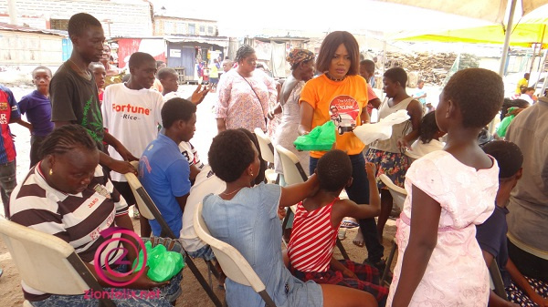 Mzbel sharing food to some beneficiaries