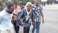 The 80-year-old leader being escorted (file)