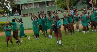 Pupils making the 'change' gesture to welcome Nana Akufo-Addo at Agric Nzema