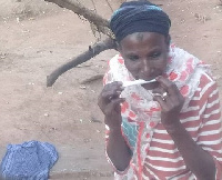 These women, some youth and children smoke the plant in a forest reserve in Kumbihini