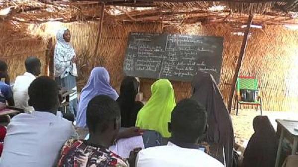 A teacher teaching the students