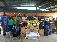 NADMO officials presenting the items to the victims