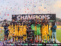 Ashgold players in jubilant mood as they lift the trophy