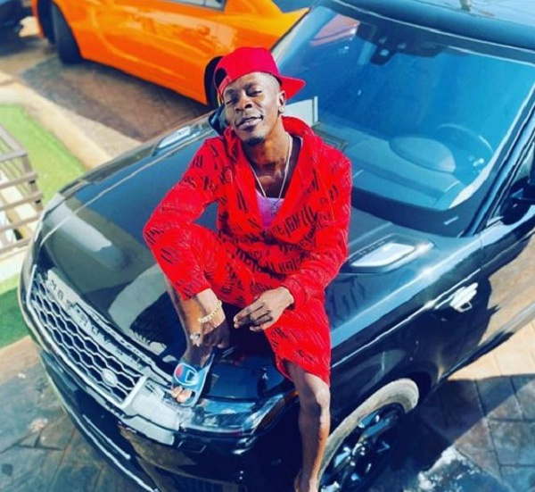 Shatta Wale flaunts remote control gate, fleet of cars in latest video