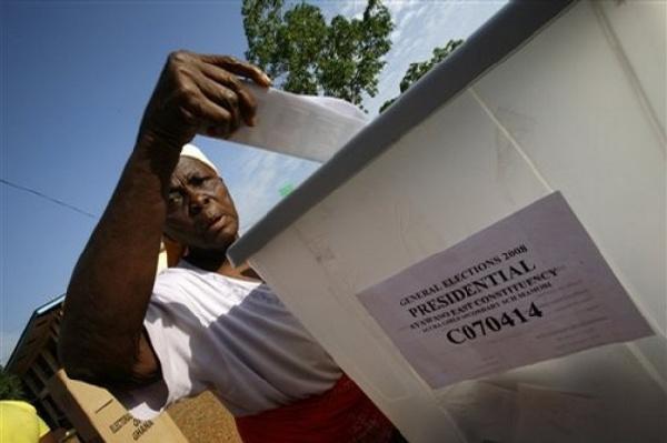 Woman casts her ballot.