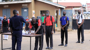 Students register and screen for Covid-19 symptoms at Luzira Secondary School