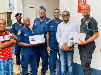 Ernest Egyir (in jeans) with representatives of the Saltpond Municipal Police
