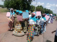 Widows marching on the streets of Bolgatanga to present the communiqué to the Regional Minister