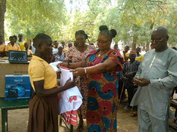Nadowli-Kaleo DCE, Katherine T. Lankono presents the uniforms to the students