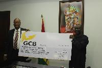 Managing Director of GCB Bank, Mr Anselm Ray Sowah with Ken Ofori Atta