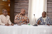 Former President Mahama (middle) and Mr. Ofosu Ampofo (right)