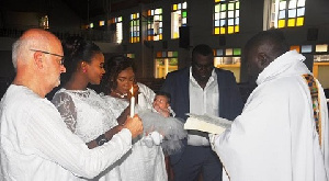 The actress and her husband dedicate their baby at St. Peter