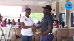 Gifty Appiah presenting a trophy to one of the winners