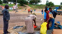 Women dealing in mukene attend to customers at Lambu Landing Site