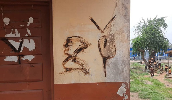 A photo of a defaced house