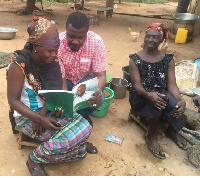 John Dumelo explaining how works of the NDC in the greenbook to the natives