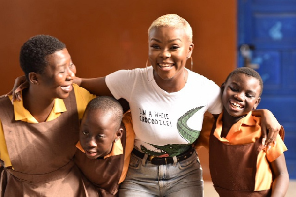 Gifty Louise Agyeman with some of the pupils