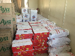 The items are bags of rice, boxes of cooking oil, boxes of mackerel, and boxes of tomato paste