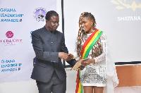 Shatana receiving her awards at the event