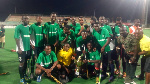 Players of Exchequers pose with the Homowo gala trophy after their victory over GRA