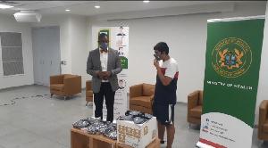 Rudra Raj handing over the face masks to Deputy Health Minister Okoe Boye