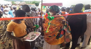 Kwaku Asante-Boateng (in smock) and stakeholders commissioning one of the classroom blocks