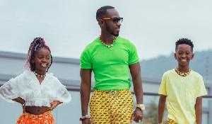Okyeame Kwame poses with his kids