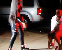 Shatta Michy dressed in a leather leotard hilariously whips him