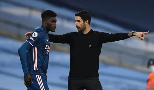 Thomas Partey with Mikel Arteta