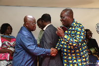 Dr. Anthony Yaw Baah and Nana Akufo-Addo exchange handshake