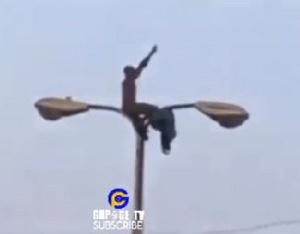 Diehard SM fan captured on the electric pole at Bukom