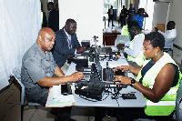 Mr Muhamed Abdul-Samed Gunu, Mr John Osei Frimpong being registerd for the card