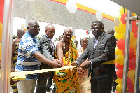 Cutting of tape by Mr. David Mureithi (2n ... tation retailer and other dignitaries
