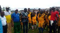 Tarkwa-Nsuaem Municipal Chief Executive, Gilbert Ken Asmah on the field with some of the teachers